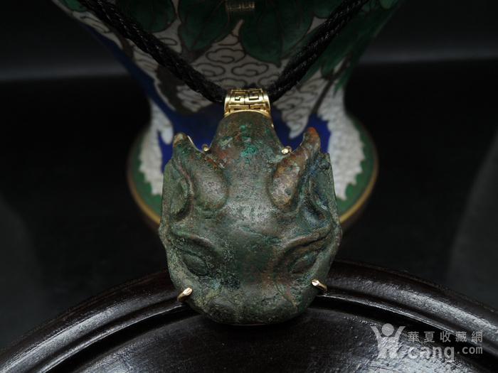 战汉青铜兽首包金