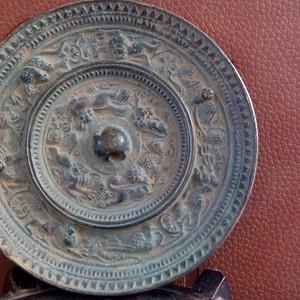 海兽葡萄花鸟纹铜镜