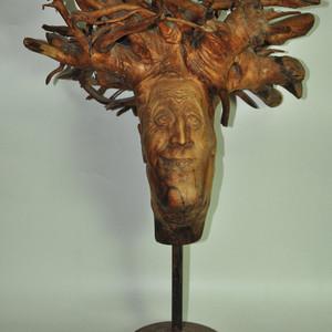 四川凉山彝族人像木雕