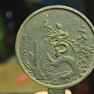 日本刻花带柄铜镜