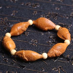 天然橄榄核雕鱼手串