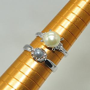 镶珍珠戒指两个