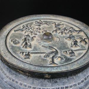 宋代花鸟人物纹铜镜
