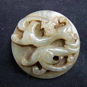 和田白玉圆雕螭龙兽面纹璧