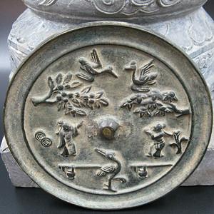 花鸟人物铜镜