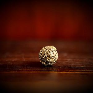 回流 清代铜鎏金满工錾刻绪缔珠一颗