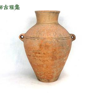 西周 红陶划花网纹双系壶