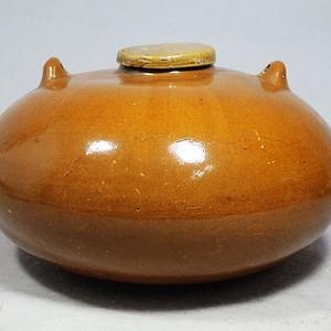 清代黄釉暖手炉
