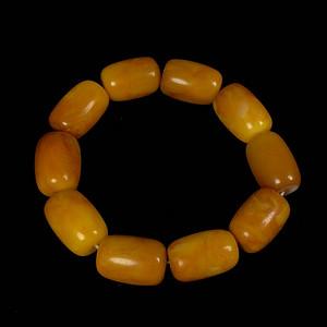 波罗的海鸡油黄蜜蜡桶珠手钏