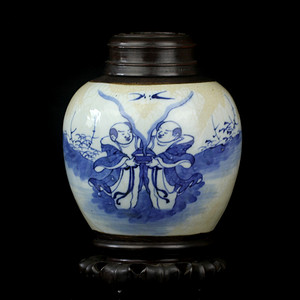 21清中期哥釉铁锈青花和合二仙纹盖罐