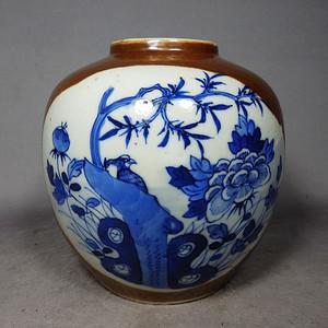 清代紫金釉青花花鸟开窗绘画罐