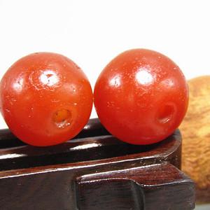唐 红玛瑙珠 两颗 风化清晰 包浆熟润