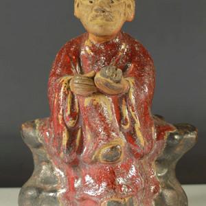 清代红釉石湾瓷塑老人