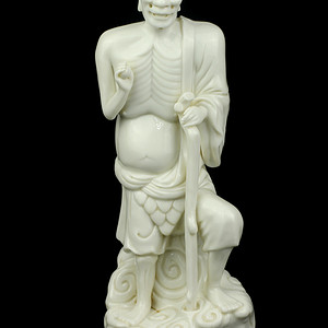 9清早期德化窑白釉铁拐李瓷像