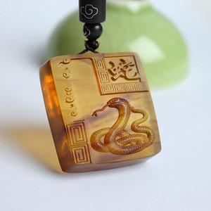棕红缅甸琥珀生肖蛇吊坠 22KQ13