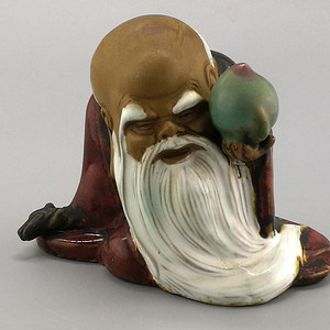 战国红釉寿星塑像