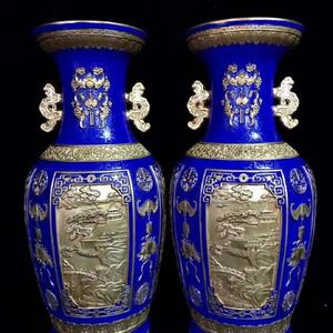 精品本金浮雕宝石蓝地爬花开窗山水人物纹双耳瓶一对